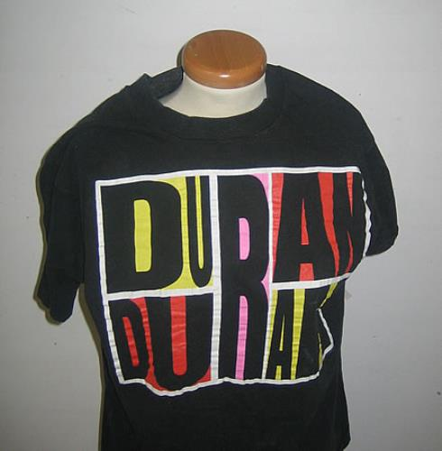 43f9f9b6996 DURAN DURAN Abstract Idealist Romantic (Superb official 1988 US vintage  100% cotton black short sleeved roll necked T-shirt with large  multicoloured band ...