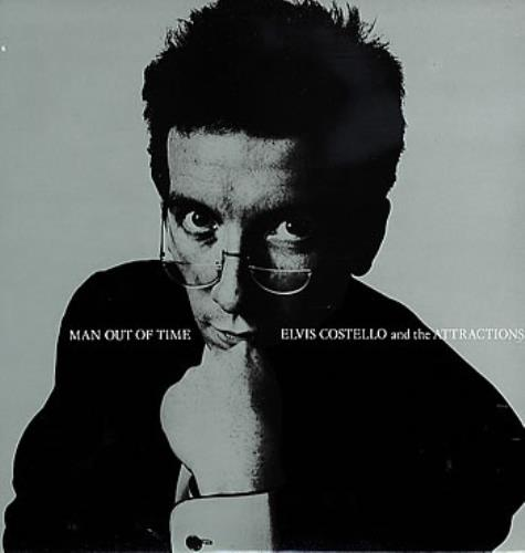 """Elvis Costello Man Out Of Time 12"""" vinyl single (12 inch record / Maxi-single) UK COS12MA92083"""