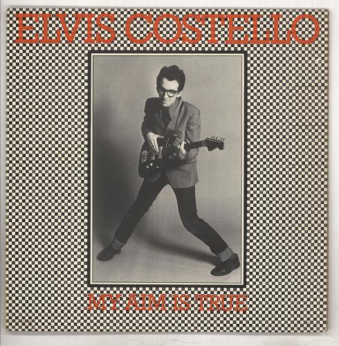 Elvis Costello My Aim Is True - Laminated - Yellow back - EX vinyl LP album (LP record) UK COSLPMY738189