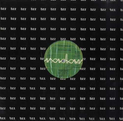 "Elvis Costello Radio Radio 12"" vinyl single (12 inch record / Maxi-single) UK COS12RA42878"