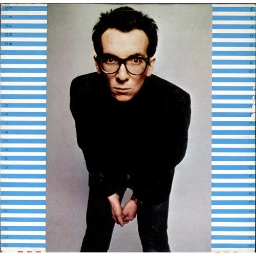 "Elvis Costello Watching The Detectives - Yellow Vinyl 7"" vinyl single (7 inch record) Belgian COS07WA424490"