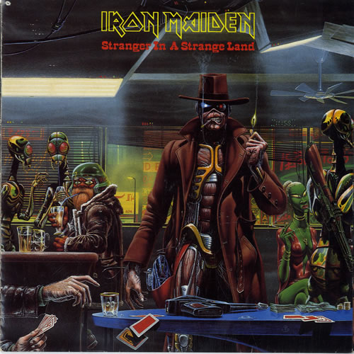 "Iron Maiden Stranger In A Strange Land - Poster - EX 7"" vinyl single (7 inch record) UK IRO07ST563767"