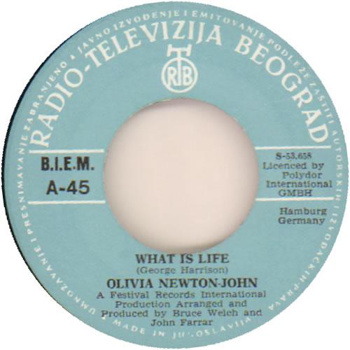 "Olivia Newton John What Is Life 7"" vinyl single (7 inch record) Yugoslavian ONJ07WH641413"