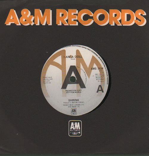"Shrink I Am A Doll - A-Label 7"" vinyl single (7 inch record) UK WX007IA635973"