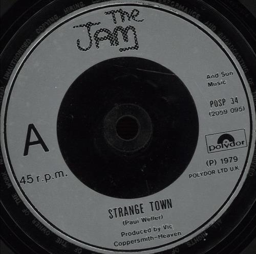 "The Jam Strange Town - Inj 7"" vinyl single (7 inch record) UK JAM07ST643608"