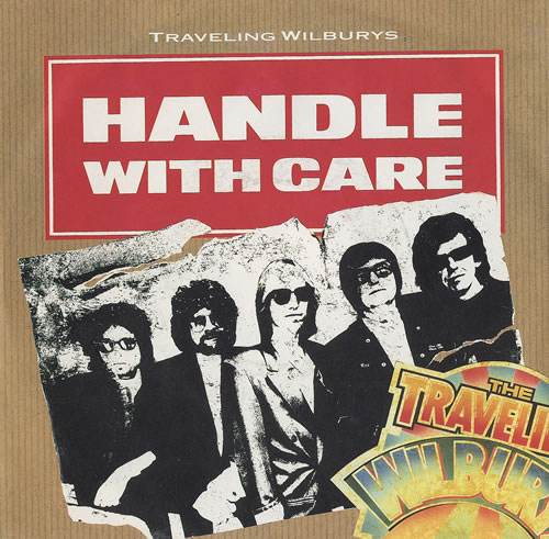 """Traveling Wilburys Handle With Care - White Titles 7"""" vinyl single (7 inch record) German TRV07HA45405"""